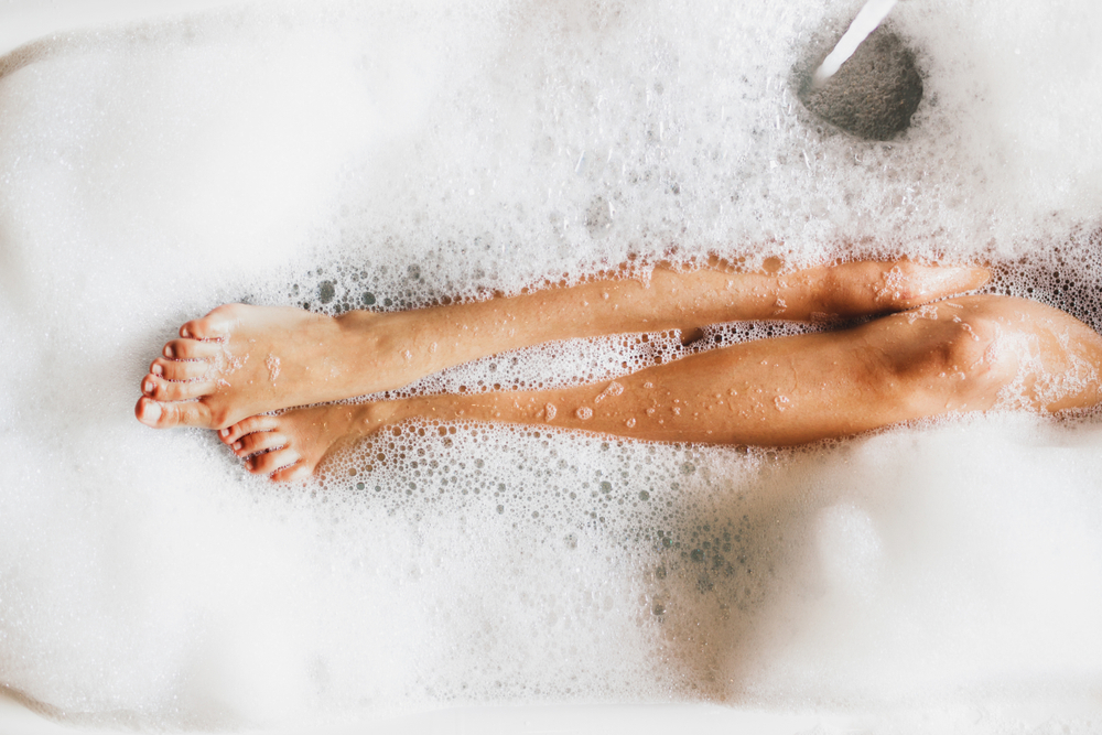 Woman,Legs,In,Bath,Foam.,Top,View.,Enjoying,And,Relaxation